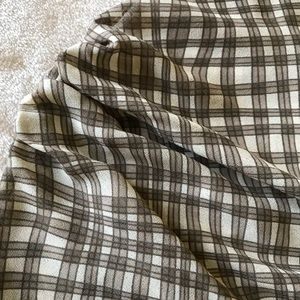 Ruffled plaid blouse in black and off/white